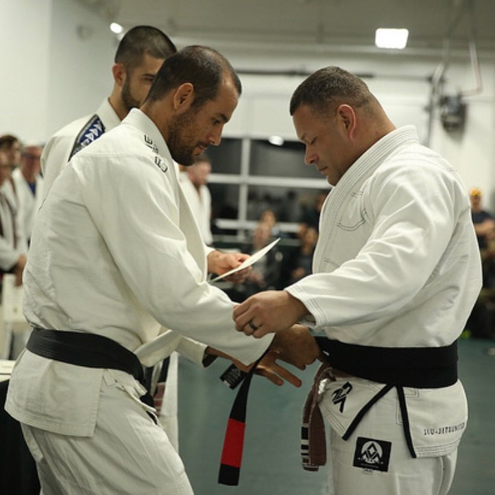 Tony D receiving his black belt from Ryron Gracie