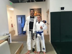 Young Ben Rhoton standing with the very tall Rener Gracie